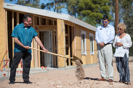 File: Supervisor Chairman Richard Elías shovels earth at Oct. 2017 groundbreaking ceremony.