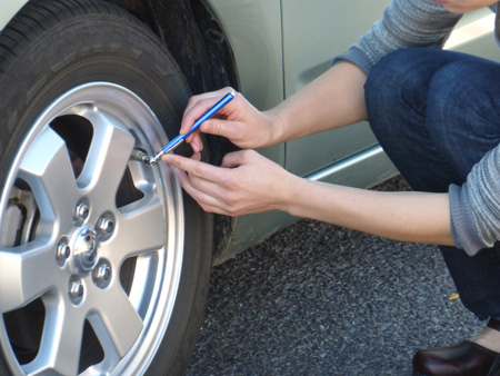 Use Tire Gauge to Check Air Pressure