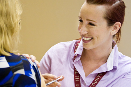 A Public Health Nurse gives a flu vaccine