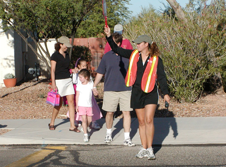Crossing Guard and Family Walking to School