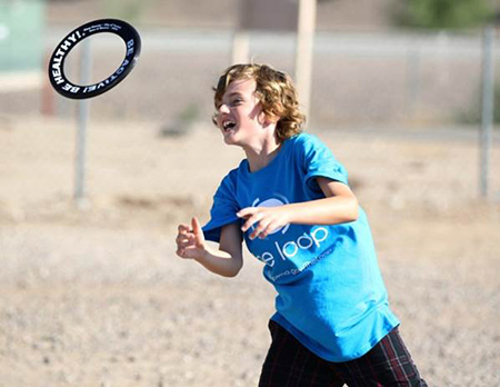 Boy Throwing Frisbee